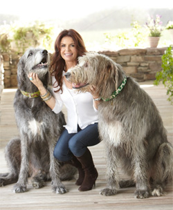 Picture of Roma Downey with her two SCottish bloodhounds